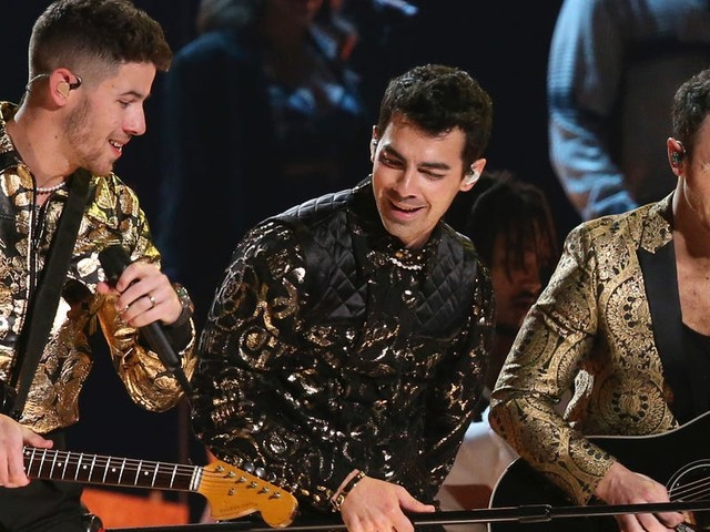 The Jonas Brothers surprise fans at the Grammys by revealing they have another album on the way