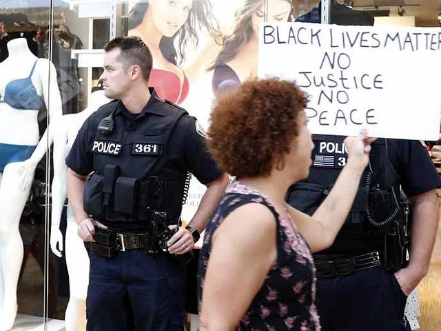 "Protesters Storm St. Louis Mall Chanting ""No Justice, No Profits"" As U2 Cancels Concert"