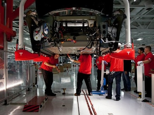 Musk said 'manufacturing design improvements' are coming to the Model 3 — former Tesla engineers told us what that could mean (TSLA)