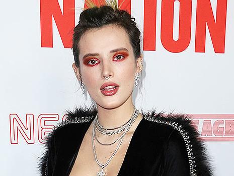 Bella Thorne Becomes A 'Disco Queen' With Huge Pink Wig & Wild Makeup