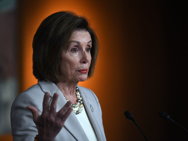 Pelosi leads a surprise delegation to Jordan for 'vital discussions' on Syria crisis