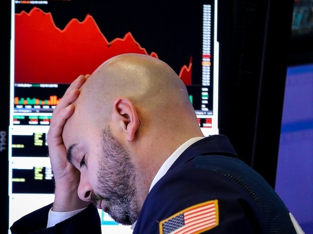 The Dow plunges almost 500 points as weak economic data reignites recession fears