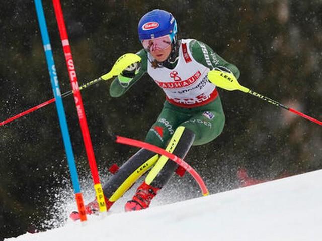 The Latest: Shiffrin fights illness in bid for slalom gold