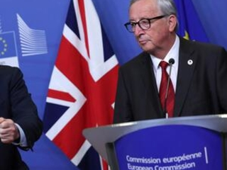 The Latest: EU lawmakers might not OK Brexit deal by Oct. 31