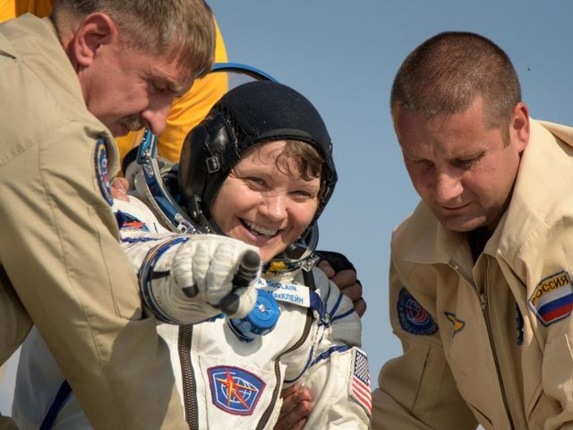 Soyuz capsule safely returns three space station crew members to Earth