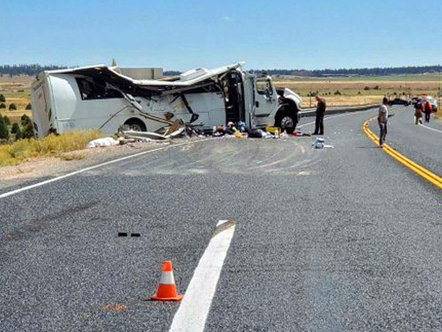 The Latest: Up to 15 critically injured in deadly bus crash