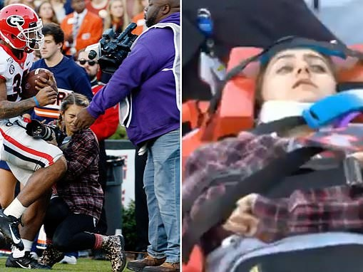 Photographer is knocked unconscious by college running back who crashes into her on the sideline