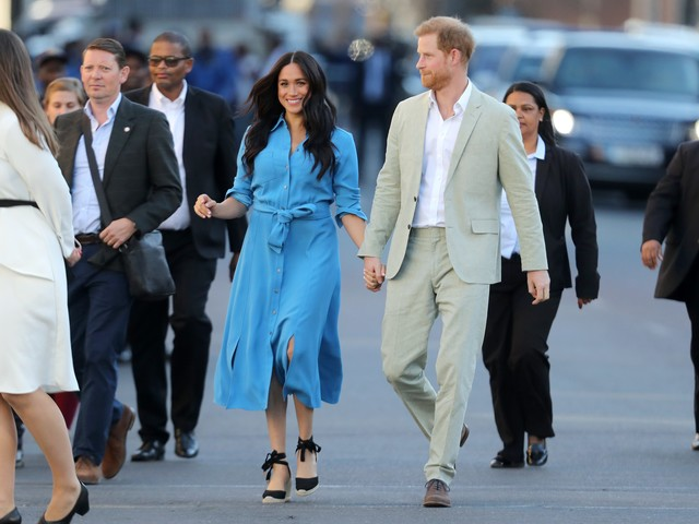 Prince Harry, Duchess Meghan kick off South Africa royal tour with dancing, stunning fashion