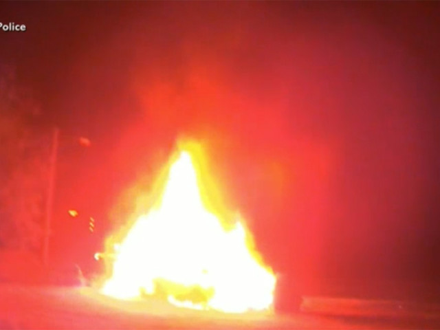 Hero cops save Virginia woman from burning car moments before explosion | VIDEO