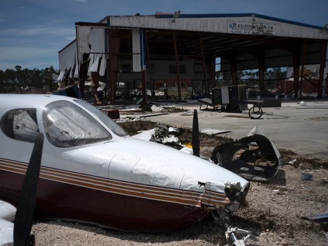 Photos show the mangled airplanes and buildings at Grand Bahama airport that Hurricane Dorian left behind