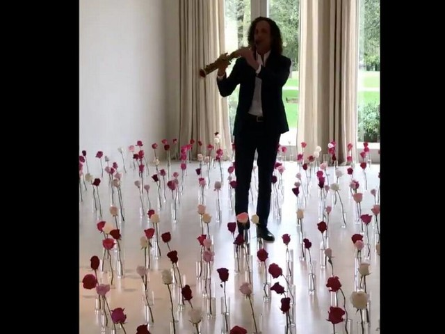 Why did Kanye West give Kim Kardashian a performance by Kenny G for Valentine's Day?