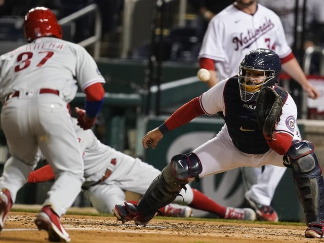 Phillies rally off Nationals closer Brad Hand, collect 5-2 win in 10 innings