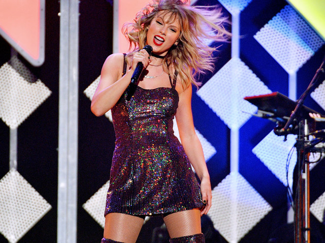 Taylor Swift rings in her 30th birthday with Jingle Ball concert and cake decorated with cats