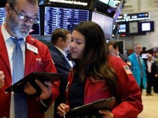 Tech companies, banks boost stocks; Boeing drops again