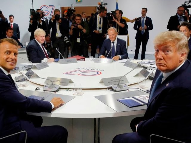 Tense meetings, protesters, and a surprise arrival: 7 photos show just how the first days of the G7 Summit played out