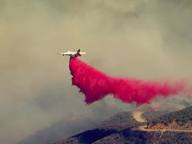 Corona brush fire: Firefighters battling fast-moving flames