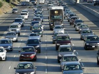 23 states widen challenge to Trump administration car rules