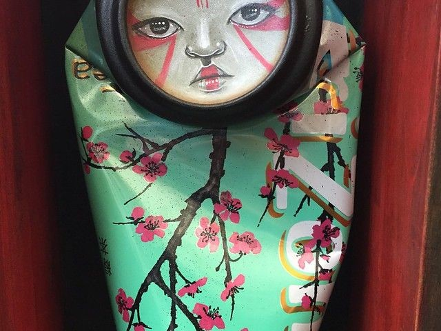 Artist Brings Discarded Cans Alive with Faces