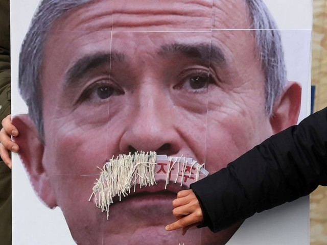 US envoy say it's his mustache; South Koreans say otherwise