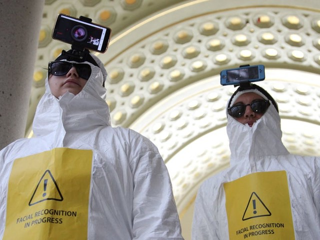 Facial recognition protesters put smartphones on their heads to scan the faces of 13,000 Washington DC inhabitants