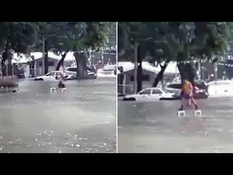 Clever Student Crosses Flooded Street Using Just 2 Chairs