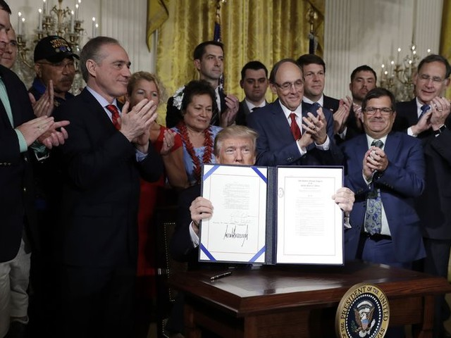 Donald Trump signs VA accountability act into law, promises better care for veterans
