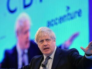 UK parties woo wary business chiefs; Johnson faces questions