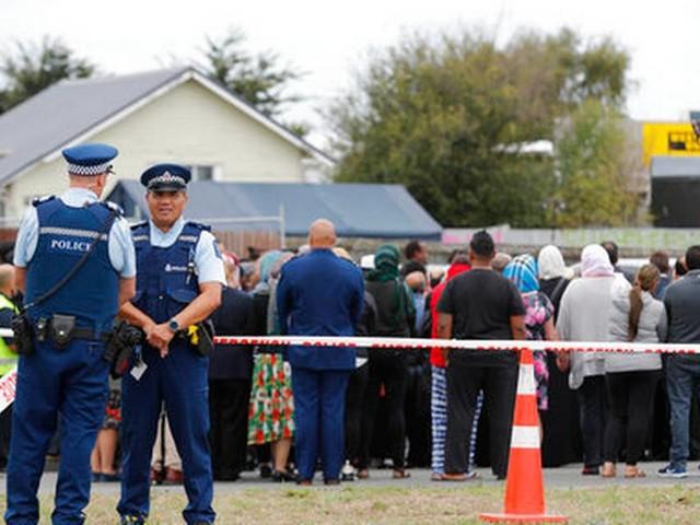 The Latest: Police raid homes in Australia to aid NZ probe