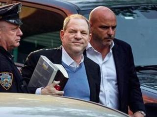Weinstein turns himself in holding 2 entertainment bios