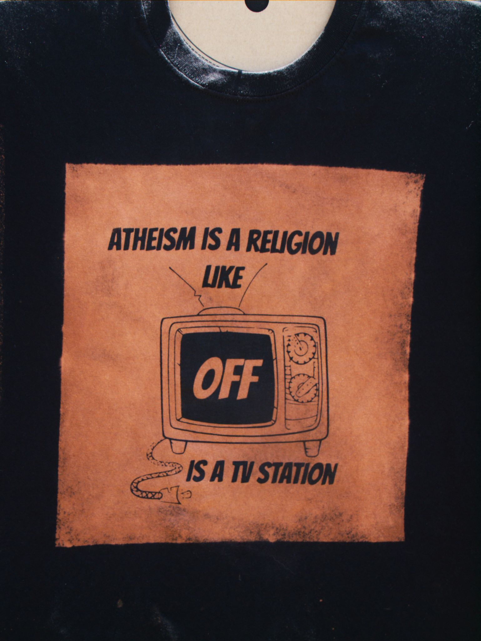 Atheism is a religion like off is a tv station discharge ink tee shirt design