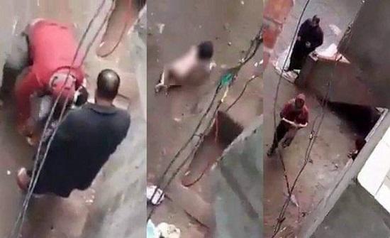 مشاهد صادمة  .. مصر  : اب يعرّي ابنته بالشارع ويحاول حرقها