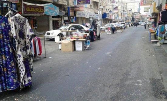 المحال التجارية في اربد تلتزم بإجراءات السلامة العامة