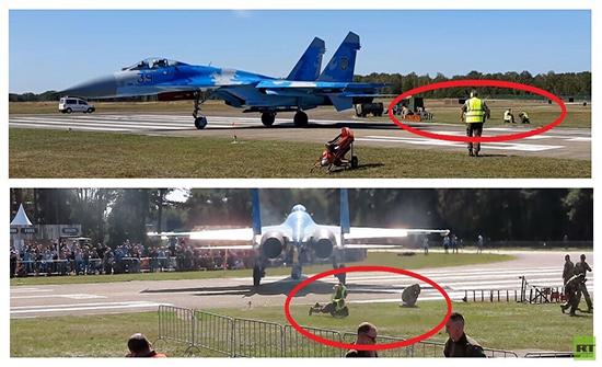 "فيديو : تطاير رجلين تحت تأثير محرك مقاتلة ""سو 27"""