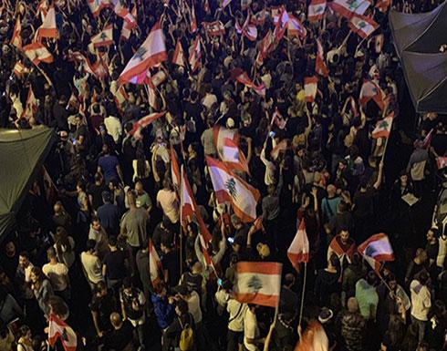 بالفيديو : اشتباك بالأيدي بين عناصر لحزب الله ومتظاهرين ببيروت
