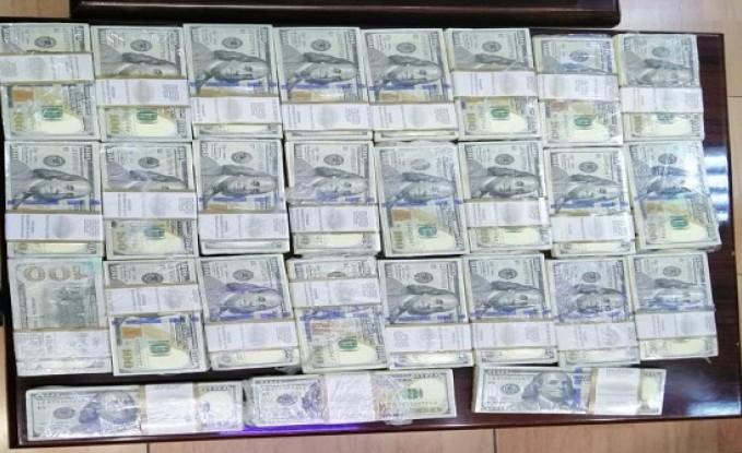 مداهمة شقة في عمان واحباط محاولة احتيال ب ٢٥٠ الف دولار