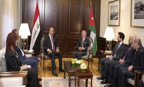 الملك والرئيس العراقي يؤكدان الاستمرار في تطوير التعاون الأردني العراقي