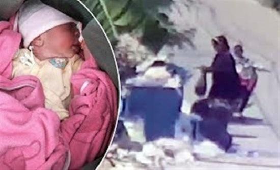 لقطات صادمة لرصد أم ترمي طفلها حديث الولادة في الزبالة (فيديو)