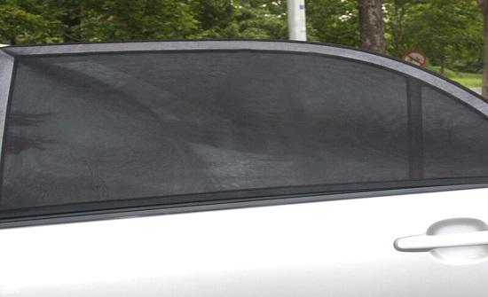 """""""السير"""": إضافة قطعة قماش لنافذة المركبة يعتبر مخالفة"""