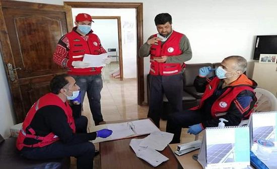 الهلال الأحمر يوزع طرود تكية أم علي في عجلون