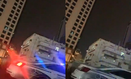 شاهد.. تصفيق حار وتحية لرجال الأمن في أحد العمارات المحجورعليها في الكويت
