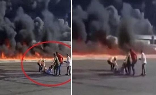 لحظة إنقاذ مصري قبل أن تلتهمه النيران - فيديو