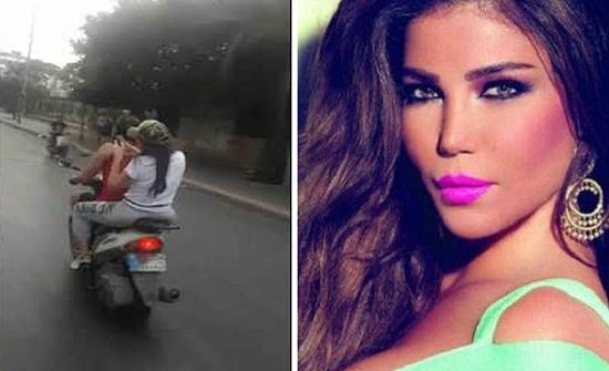 بالفيديو: مي حريري تتنقل على متن دراجة نارية بسبب قطع الطرق