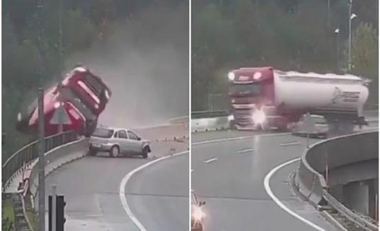 بالفيديو : شاحنة ضخمة تسقط بطريقة مروعة من أعلى جسر في اوروبا