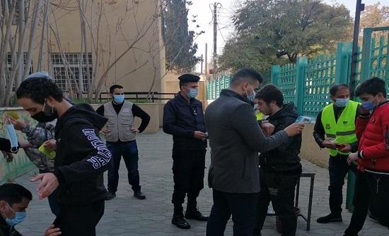 متطوعو المجلس الأمني في منطقة زهران يدعمون جهود التربية في الحماية من كورونا
