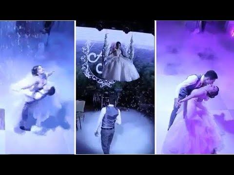 بالفيديو.. عروس تهبط للقاعة بأرجوحة وتشارك العريس رقصة مميزة