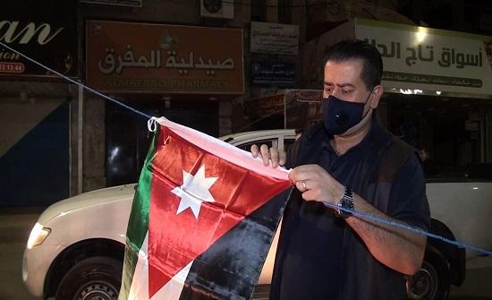 حملة لتوزيع العلم الأردني في إربد