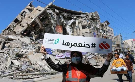 الغزيون يبدأون حملة لإزالة آثار العدوان الإسرائيلي (صور)