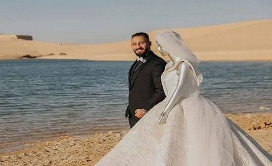 خوفا عليها من الظهور ..عريس يستبدل عروسه المنتقبة بـ «مانيكان» - صور