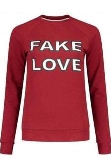 Nikkie by nikkie fake love sweater wine