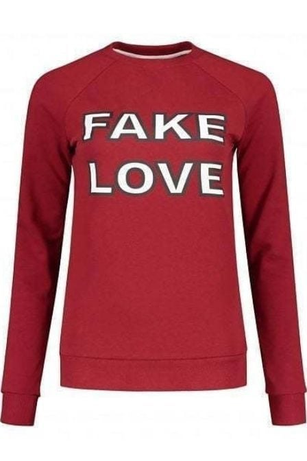 Nikkie by nikkie fake love sweater wine